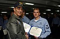 US Navy 030214-N-2410G-001 Vice Adm. Scott Fry, Commander Sixth Fleet, presents Aviation Warfare Systems Operator 2nd Class Aaron Albright with a Navy Marine Corps Achievement Medal.jpg