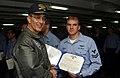US Navy 030214-N-2410G-001 Vice Adm. Scott Fry, Commander Sixth Fleet, presents Aviation Warfare Systems Operator 2nd Class Aaron Albright with a Navy Marine Corps Achievement Medal.jpg
