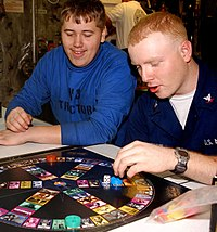 US Navy 030305-N-0923G-035 Airman Eric Micolichek and Machinist^rsquo,s Mate 3rd Class Walter Blackburn play Trivial Pursuit during game night aboard the aircraft carrier USS Harry S. Truman (CVN 75).jpg