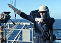US Navy 031009-N-9871P-001 Signalman 3rd Class Marcus Pennix, from Greensboro, N.C., practices semaphore.jpg
