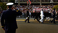 US Navy 040609-N-9731T-089 Former President Ronald Reagan's horse-drawn casket is saluted by a U.S. Coast Guardsman.jpg