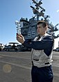 US Navy 040626-N-5952R-021 Aerographer's Mate 3rd Class Blaine Knab, from Manitowoc, Wis., uses a hand-held anemometer.jpg