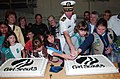 US Navy 041030-N-8148A-038 Commanding Officer, USS Ronald Reagan (CVN 76), Capt. James Symonds, is assisted by Girl Scouts from the San Diego-Imperial County Council, while cutting a cake to celebrate Girl Scouts founder Juliet.jpg