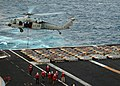 US Navy 041115-N-1082Z-015 An MH-60S Knighthawk helicopter transports pallets of 2000 pound general purpose bombs.jpg