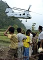 US Navy 050116-N-6817C-246 A U.S. Marine Corps CH-46E Sea Knight lifts off from a village on the island of Sumatra, Indonesia after delivering relief supplies and disaster relief teams.jpg