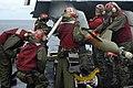 US Navy 050623-N-8604L-048 Aviation Ordnancemen load a GBU-16, 1,000-pound laser guided bomb, onto an F-A-18C Hornet weapon station.jpg