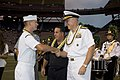 US Navy 051112-N-8157C-014 Chief of Staff, U.S. Pacific Command, Rear Adm. William Alford presents a plaque to Electronics Technician 3rd Class Irvine R. Rash of Pearl Harbor Naval Shipyard.jpg