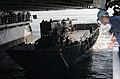 US Navy 060420-N-3970R-172 Seaman Scott Napack assist Landing Craft Unit One Six Two Nine (LCU-1629) assigned to Assault Craft Unit One (ACU-1) from the well deck.jpg