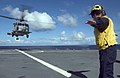 US Navy 060522-N-9851B-001 Quartermaster 3rd Class Christian Castillo directs an SH-60B helicopter assigned to the Easy Riders of Helicopter Anti-Submarine Squadron Light Three Seven (HSL-37) as it takes off from the flight dec.jpg