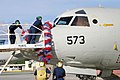 US Navy 060602-N-3207B-069 Sailors assigned to the Golden Swordsmen of Patrol Squadron Four Seven (VP-47) carefully place a lei on the first P-3C Orion to return home from deployment.jpg