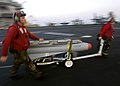 US Navy 060607-N-9742R-361 Sailors assigned to the Checkmates of Strike Fighter Squadron Two One One (VFA-211), transport a Maverick laser-guided missile on the flight deck of the nuclear-powered aircraft carrier USS Enterprise.jpg