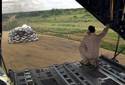 US Navy 061110-N-3884F-035 An Air Force C-130H Hercules aircraft assigned to Combined Joint Task Force Horn of Africa (CJTF-HOA) delivers humanitarian aid to flood victims in the Ogaden region of Ethiopia.jpg