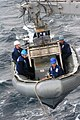 US Navy 061201-N-6423H-007 Sailors aboard the amphibious transport dock ship USS San Antonio (LPD 17) lower a boat crew into heavy seas while answering a distress call from the fishing vessel Miss Melissa.jpg
