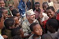 US Navy 061202-F-4925S-062 U.S. Navy. Capt. Kevin Hutcheson, Combined Joint Task Force-Horn of Africa (CJTF-HOA) deputy political advisor, shares a moment with children who are living in a tent city set up by CJTF-HOA.jpg