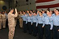 US Navy 061221-N-9988F-001 Chief of Naval Operations (CNO) Adm. Mike Mullen administers the oath of reenlistment.jpg