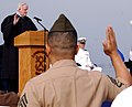 US Navy 070404-N-4163T-176 A Marine recites the Oath of Allegiance to become an American citizen during a naturalization ceremony held aboard the amphibious transport dock ship USS Cleveland (LPD 7).jpg