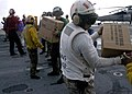 US Navy 070907-N-1189B-062 Sailors on board multi-purpose amphibious assault ship USS Wasp (LHD 1), load Meals, Ready-to-Eat (MREs) onto an MH-60S Seahawk assigned to Helicopter Sea Combat Squadron (HSC) 28.jpg