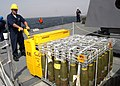 US Navy 070918-N-4649C-110 Gunner's Mate 1st Class Matt Kelly loads ordnance onto an elevator aboard Arleigh-Burke class guided-missile destroyer USS Lassen (DDG 82) during an ammunition onload.jpg