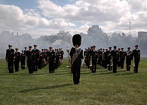 US Navy 071001-N-0773H-034 The United States Navy Ceremonial Band, under the direction of Drum Major, Master Chief Musician Joe D. Brown Jr., stands at attention as smoke from the gun salute for Marine Gen. Peter Pace drifts pa.jpg