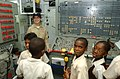US Navy 080703-N-8943B-019 Lt. Jennifer Free, chief engineer aboard the frigate USS Simpson (FFG 56) conducts a tour for students from Gordon ^ Walcott Memorial Methodist School.jpg