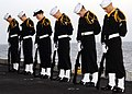 US Navy 090224-N-2562S-003 Members of the Honor Guard of the aircraft carrier USS Theodore Roosevelt (CVN 71) bow their heads in prayer during a burial at sea.jpg