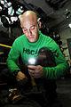US Navy 090505-N-2475A-041 Aircrew Survival Equipmentman 2nd Class Jason Bruce, from San Diego, checks the emergency signal strobe light on a CMU33 survival vest.jpg