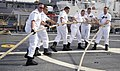 US Navy 090506-N-7090S-221 The Sailors attached to the littoral combat ship USS Freedom (LCS 1) handling lines to get the ship underway.jpg