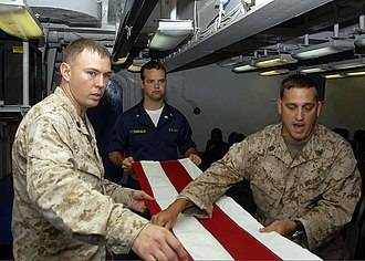 United States Flag Code - Image: US Navy 090706 N 5712P 021 Gunnery Sgt. William Ward and Gunnery Sgt. Daniel Fowler, both embarked aboard the amphibious assault ship USS Nassau (LHA 4), teach Midshipman 1st Class William Fitzgerald, from the U.S. Naval Academ