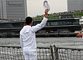 US Navy 090722-N-3283P-124 A Sailor aboard the guided-missile destroyer USS John S. McCain (DDG 56) waves goodbye to the residents of Yokohama as the ship departs Osanbashi Pier.jpg