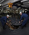 US Navy 090914-N-6538W-004 Sailors assigned to deck department, 1st Division remove the anchor chain cover above the starboard side haws pipe.jpg