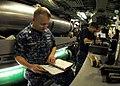 US Navy 101013-N-7705S-010 Chief Machinist's Mate Tim Mecklenberg, from Killeen, Texas, verifies the maintenance procedures for torpedo room equipm.jpg
