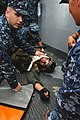 US Navy 101210-N-3686T-369 Hospital Corpsman 3rd Class Zachary Trivette and medical department personnel attend to a Sailor during a mock marine c.jpg