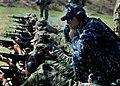 US Navy 110131-N-9318F-072 Gunner's Mate 1st Class Michael Braun helps a Colombian coastguardsman during an Amphibious-Southern Partnership Station.jpg