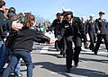 US Navy 110320-N-1752N-284 Seaman Recruit Deidre Foster, assigned to USS Constitution, gives a high-five to a child while marching in the 110th ann.jpg