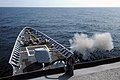 US Navy 110503-N-AE328-023 The guided-missile cruiser USS Lake Erie (CG 70) fires a 70-pound practice projectile from its 5-inch-54 caliber Mark 45.jpg