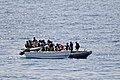 US Navy 110812-N-YM590-104 Members of a visit, board, search and seizure team from the guided-missile cruiser USS Anzio (CG 68) assist mariners abo.jpg