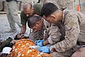 US Navy 110908-M-EU691-007 Marines and Sailors from 1st Battalion, 5th Marines, Regimental Combat Team 8, treat casualties at Forward Operating Bas.jpg