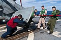 US Navy 110926-N-EA192-089 Sailors prepare a helicopter for flight operations.jpg
