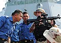 US Navy 110930-N-ED900-314 Fire Controlman 2nd Class Christi Hoopes, right, a member of the visit, board, search and seizure team.jpg
