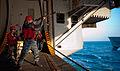 US Navy 111206-N-OY799-087 A Sailor ires a messenger line.jpg