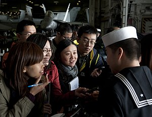 US Navy 111227-N-DR144-425 A Sailor speaks to members of the Hong Kong press.jpg