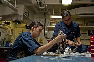US Navy 120112-N-BT887-235 Sailors clean the housing of a BRU-32 aboard the Nimitz-class aircraft carrier USS John C. Stennis (CVN 74).jpg