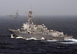US Navy 120213-N-DR144-262 The Arleigh Burke-class guided-missile destroyer USS Momsen (DDG 92) arrives alongside the Nimitz-class aircraft carrier.jpg