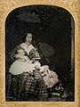 Unidentified woman and children (5570156503).jpg