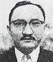 A halftoned image of a man with short hair and glasses looking ahead.