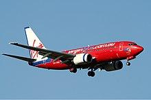 Boeing 737-700 van virgin blue landing op melbourne internasionale