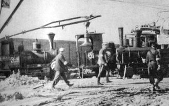 Stefan Wiechecki - Barricade made of train engines where Wiechecki edited some of the articles during the uprising; the signs and slogans painted on the engines were created by him