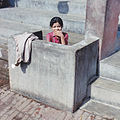 Washing girl in a toilet in India.jpg