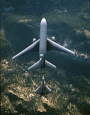 A KC-10 Extender from Travis Air Force Base, California, refuels an F-22 Raptor