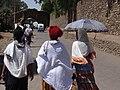 Women Stroll outside Royal Enclosure - Gondar - Ethiopia (8685169413).jpg